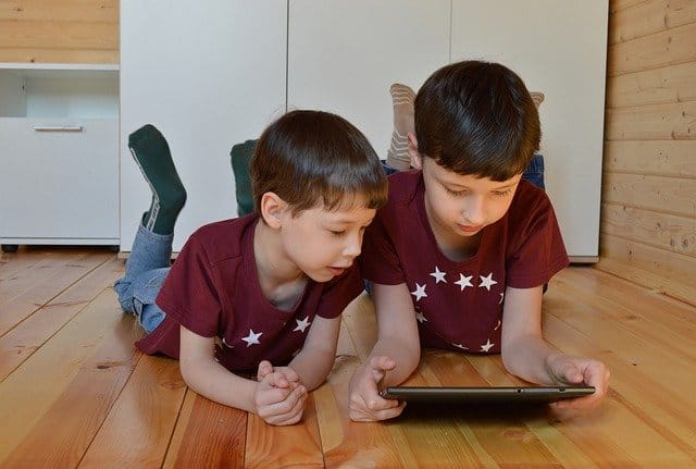 Two young boys using an ipad